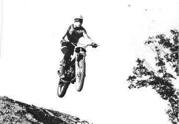 Ronald Hettich participating in motocross, 1976