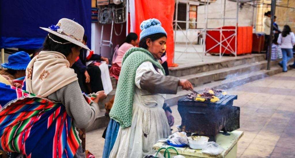 Indigenous woman cooking at shopping plaza in Bolivia