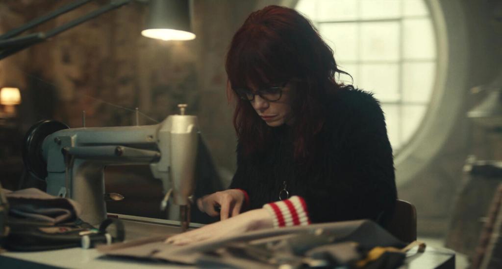 Emma Stone using sewing machine in Cruella