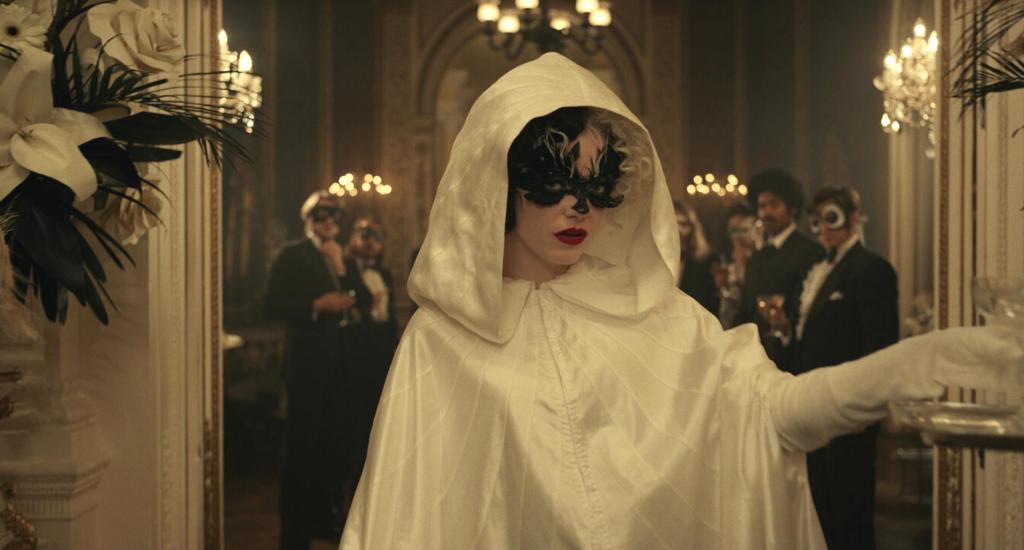 Emma Stone wearing white robe in Cruella