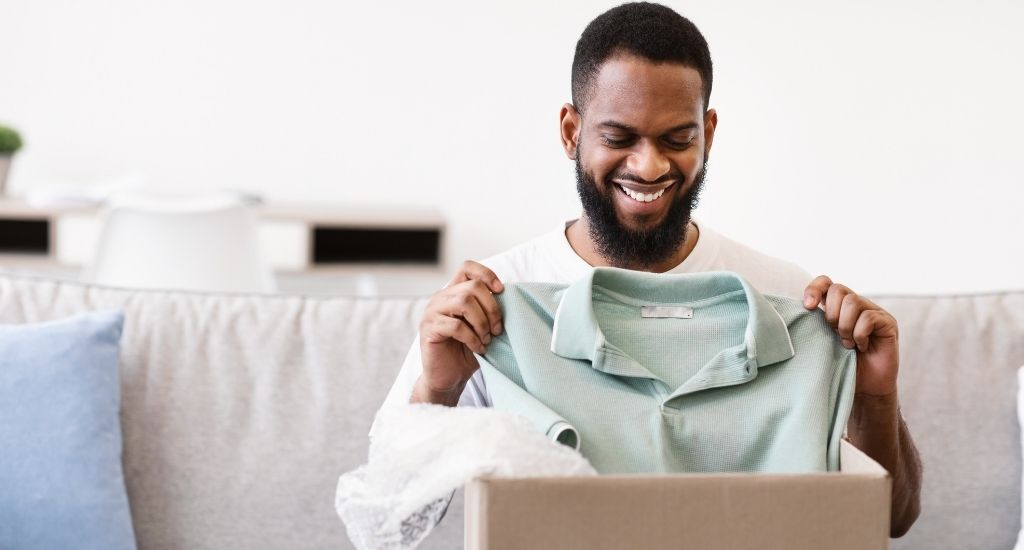 Entrepreneur unboxing clothes from online order
