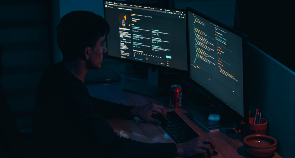 An entrepreneur building his website on dual monitors