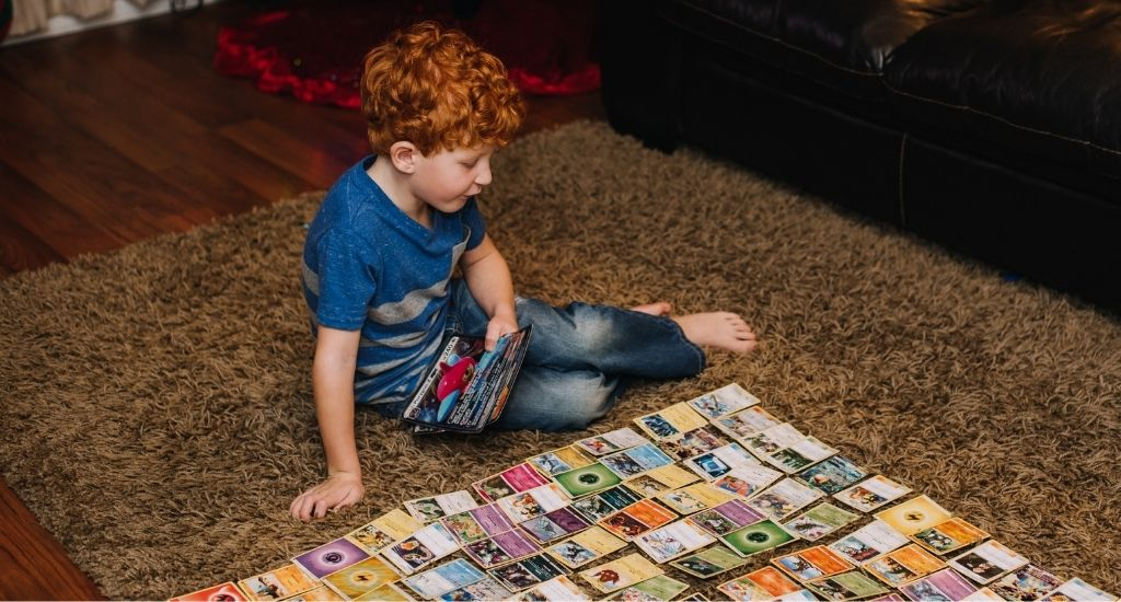 Young boy playing with his favorite cards