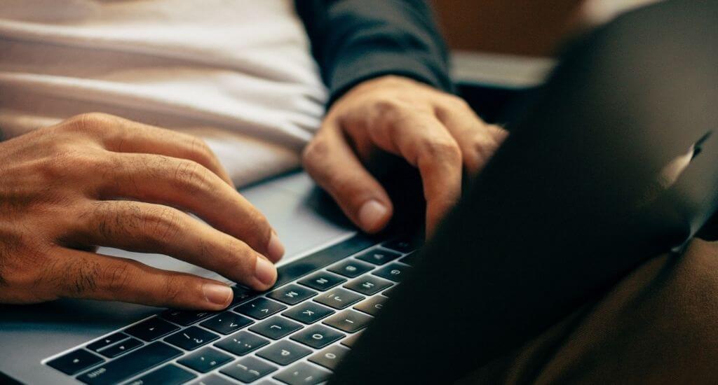 Entrepreneur taking online survey on laptop