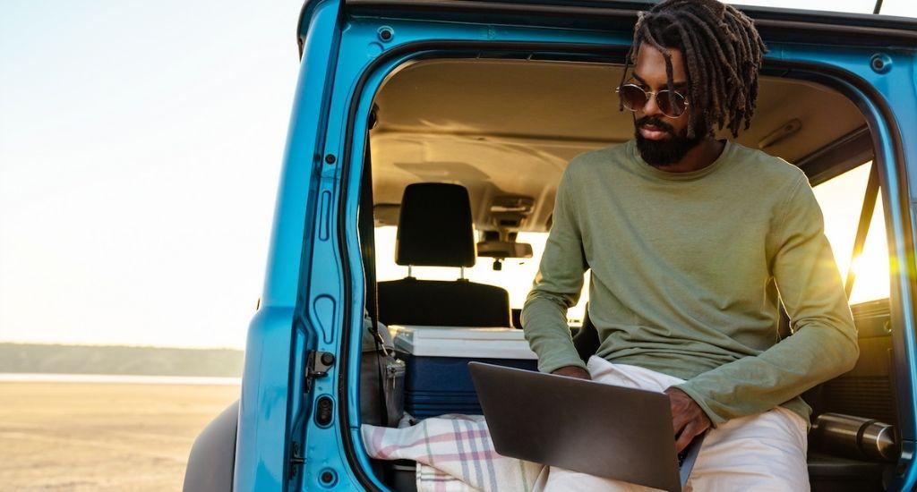 Digital nomad entrepreneur working remotely from desert