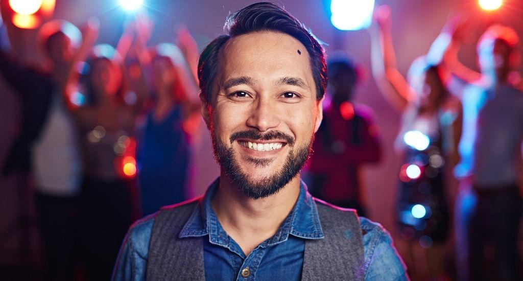 Smiling entrepreneur at work celebration