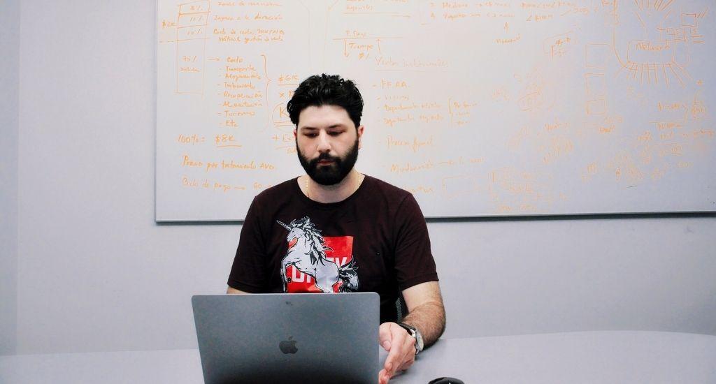 Aaron Filous working on laptop