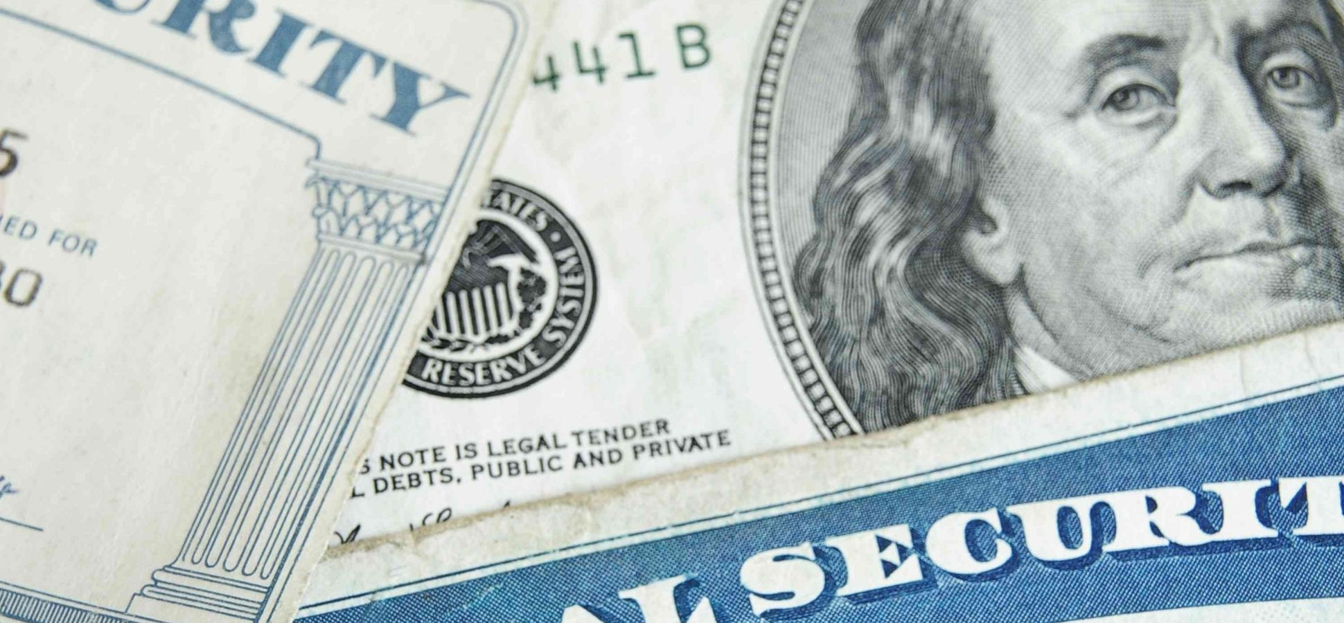Part of a Social Security Card and 100 Dollar Bill