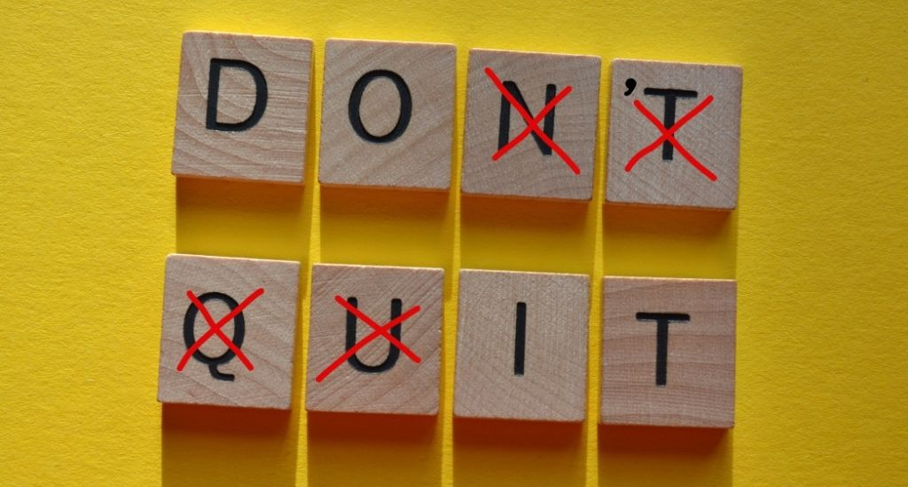 Don't quit sign with letters crossed out to say do it
